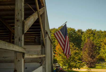 horse stable: American flag hanging from a horse stable in Snohomish Washington Stock Photo