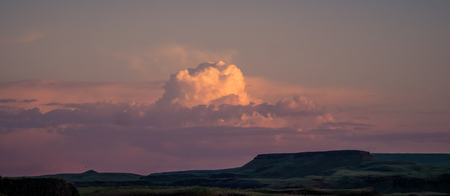 Puffy cloud over anyons near Palouse Falls at sunset 写真素材 - 103062447