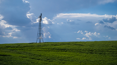 Windmill pumps water in The Palouse 写真素材