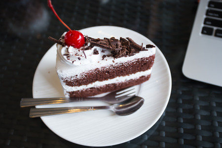 jimmies: slice of delicious chocolate cake over white Stock Photo