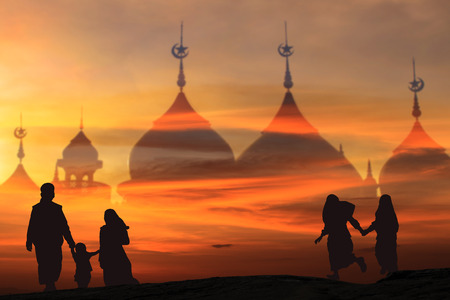 Family Muslims  pray for God  in Ramadan with hope and forgiveness of the background the mosque Stock Photo