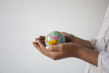 Empty hands holding the ball symbol world,concept:responsibility Save the earth for human,Abstract: Ecology The development of creativity for natural love environments