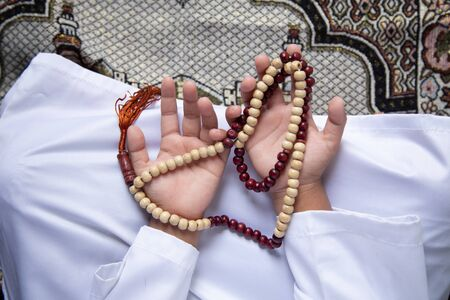 praying hands Muslim men pray to worship with faith during the Ramadan,concept: spirituality religion for hope to create inspiration for living happiness, meditation praise god for  forgiveness Standard-Bild