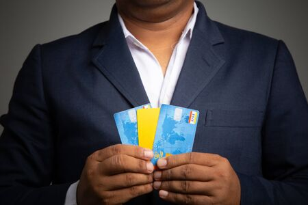 Asian Businessman holding a credit card for shopping online ,concept: Business e-Commerce banking ordering transactions for technology, online payments app entering the security in a shop Standard-Bild