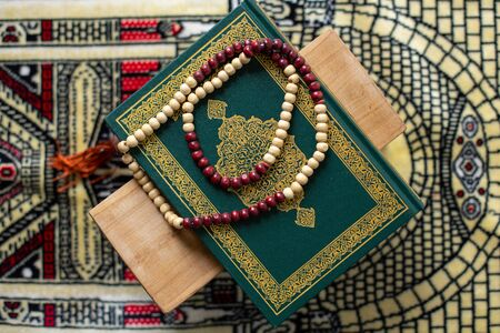 Quran - holy book of Muslims religion, Concept: open book holy prayers for god, Friday In the month of Ramadan  religion Islamic worshiping faith and learn koran and rosary put on wooden  boards