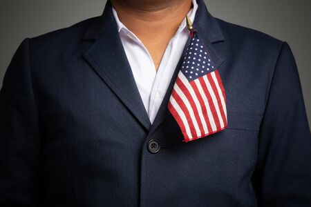 Businessman in a suit holding USA flag back background,concept:4th of July independence day, symbol celebration for success education to  patriotic, country  democracy freedom to  American Standard-Bild