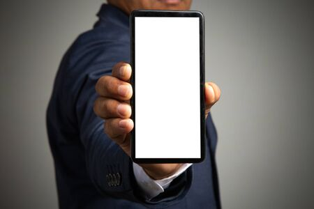 businessman working with smartphone modern devices communication technology for payments online,Concept: work at home, abstract digital devices detox entrepreneur connection success professional Standard-Bild