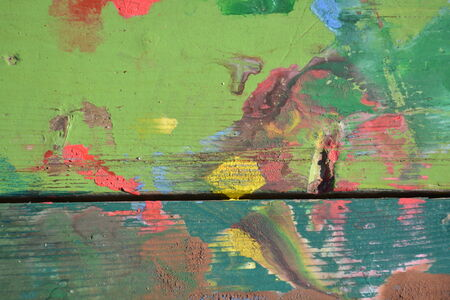 chipped: Colorful design painted on chipped and cracked wood Stock Photo
