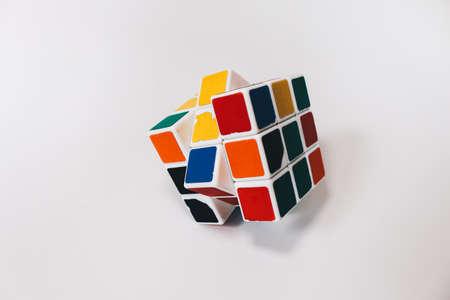 Yogyakarta, Indonesia - November, 2019: Rubik's cube toy 3x3 isolated on the white background. Solving difficult tasks.
