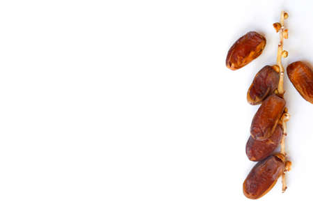 Dates fruit isolated on a white background. Top view. Flat lay pattern.