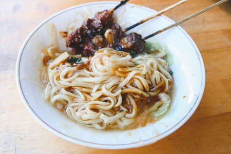 Mie Ongklok, traditional noodles from Wonosobo Indonesia with Satay.