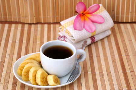 caffiene: Breakfast with a cup of coffee with banana Stock Photo