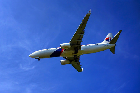 KUALA LUMPUR INTERNATIONAL AIRPORT - July 19 : Boeing 737-8H6 (9M-MXJ) Malaysia Airlines ready to land at Kuala Lumpur International Airport, Malaysia on July 19, 2014.