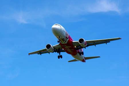 KUALA LUMPUR INTERNATIONAL AIRPORT - July 19 : Airbus A320-216 (9M-AFL) AirAsia flight ready to land at Kuala Lumpur International Airport, Malaysia on July 19, 2014.