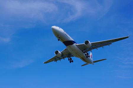 KUALA LUMPUR INTERNATIONAL AIRPORT - July 19 : Airbus A330-323 (9M-MTD) Malaysia Airlines ready to land at Kuala Lumpur International Airport, Malaysia on July 19, 2014.
