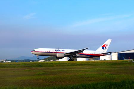 KUALA LUMPUR INTERNATIONAL AIRPORT - July 19 : Boeing 777 (9M-MRQ) Malaysia Airlines ready to land at Kuala Lumpur International Airport, Malaysia on July 19, 2014.