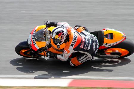 repsol honda: SEPANG, MALAYSIA-FEB 24: Dani Pedrosa of Repsol Honda Team, takes a corner at MotoGP Official Test Sepang 2 on Feb 24, 2011 in Sepang, Malaysia.