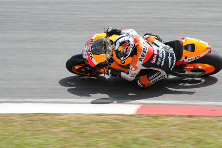 repsol honda: SEPANG, MALAYSIA - FEB 24: Dani Pedrosa of Repsol Honda Team at MotoGP Official Test Sepang 2 on February 24, 2011 in Sepang, Malaysia.