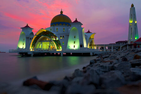 islamic scenery: Reflections of famous floating mosque on water of sea in Malacca, Malaysia, Asia.