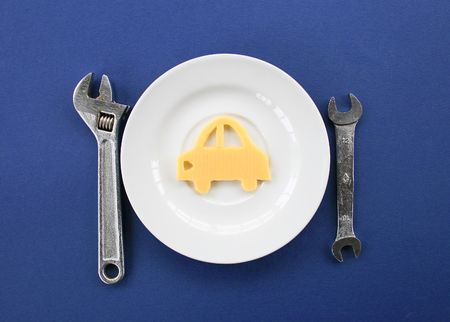 metalwork: Composition from metalwork tools and the car from cheese on a plate.