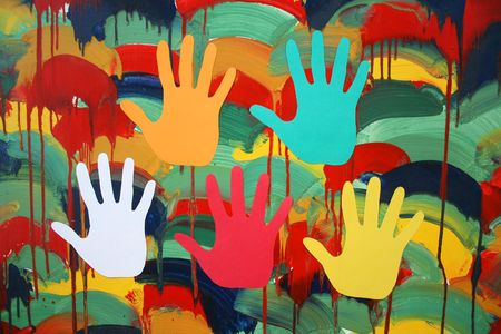 In a picture with color blots silhouettes of multi-coloured hands are represented. photo