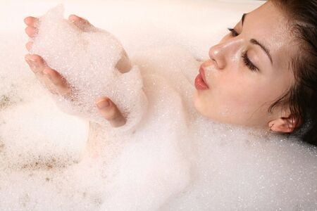 Portrait of the girl sitting in a bath. Stock Photo - 4144275