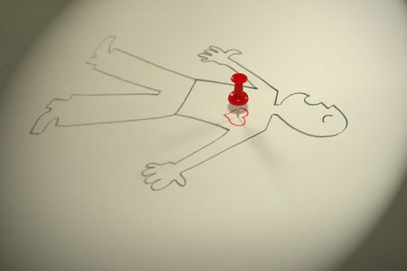 The image of the laying person with the button thrust in heart. Stock Photo - 4170199