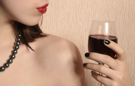 The image of the girl with the red lips, holding a glass. Stock Photo - 4166866