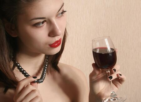 The image of the girl with the red lips, holding a glass. Stock Photo - 4189202