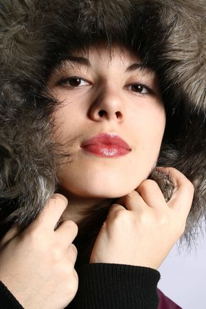 artificial hair: Portrait of the girl in a jacket with a hood.