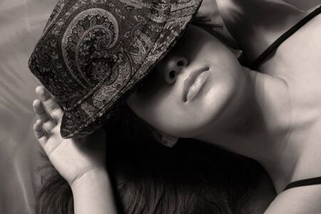 Portrait of the beautiful girl a hat covering the person. Stock Photo - 4487591