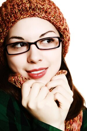 Portrait of the girl in glasses, an orange cap and a scarf.  photo