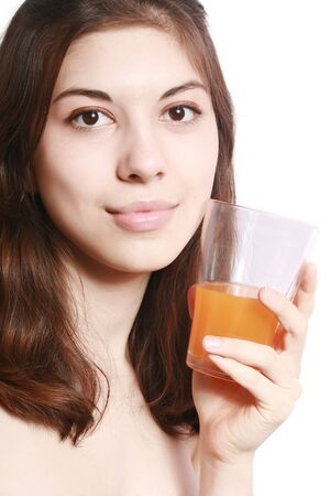 Portrait of the girl with a glass of orange juice. photo