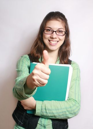 The image of the girl with the hand extended forward and lifted upwards thumb. photo