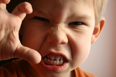 The little boy represents anger. photo
