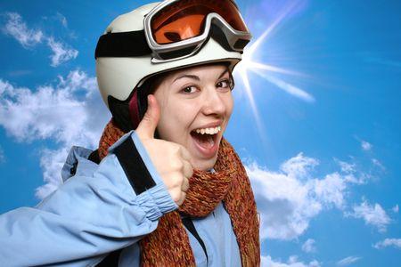 ski�r: Portret van de vrolijke meisje in een berg-ski-pak. Stockfoto