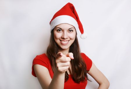Portrait of the girl in the christmas suit, showing a finger. photo