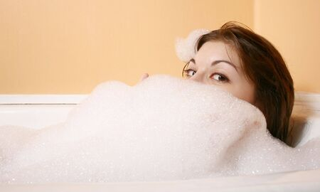 soapsuds:  Portrait of the girl sitting in a bath.