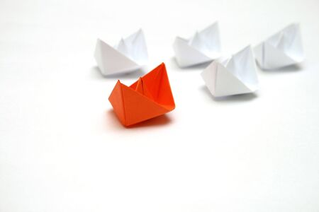 Flotilla of the paper ships led by the red ship photo