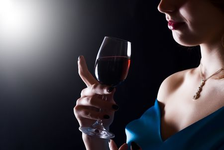 to tempt: beautiful woman with glass red wine