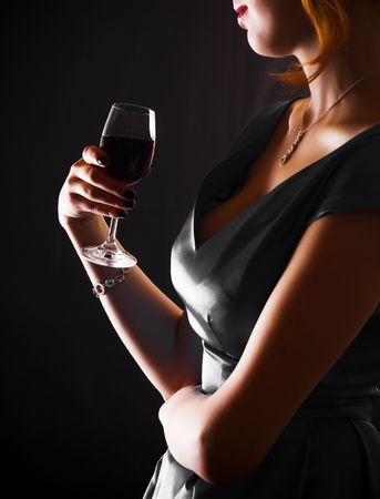allurement: beautiful woman with glass red wine