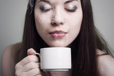 beautiful woman drinking coffee Stock Photo - 7647813