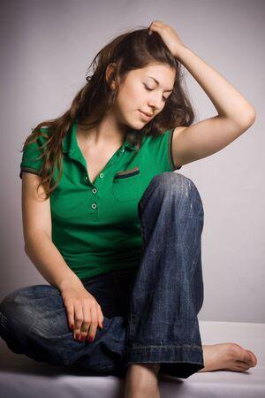 Beautiful Young Woman Sitting photo