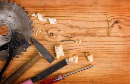 pounding head: Tools on a wooden background