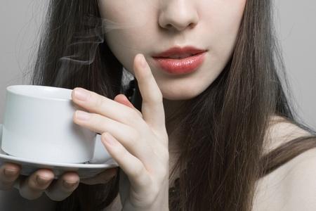 Portrait of beautiful woman drinking coffee Stock Photo - 8584903