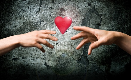 Two hands reach for the heart symbol. A symbol of health. Symbol valentines.  photo