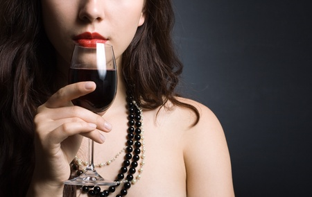 beautiful woman with glass red wine