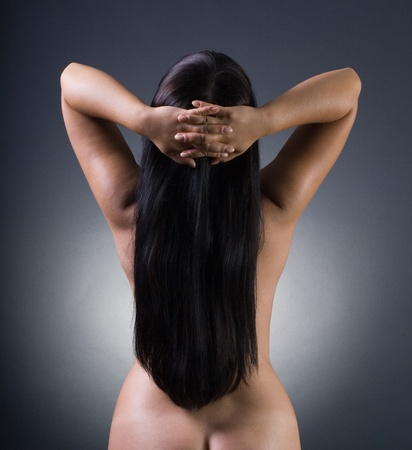 nude female buttocks: Nude beautiful young lady on black background
