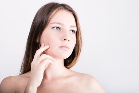 Closeup portrait of beautiful female model with blue eyes on white background photo