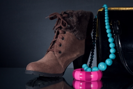 Women winter shoes and jewelry.